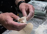 Making Tortellini pasta Stuffing the dough