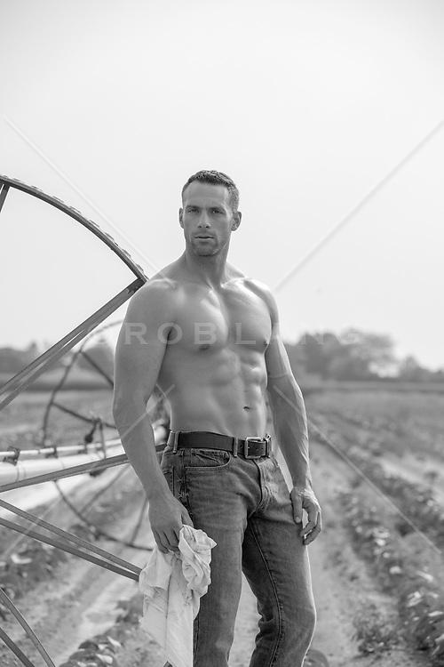 shirtless muscular farmer outdoors hot farmer in a dirty tee shirt on a farm shirtless muscular farmer outdoors