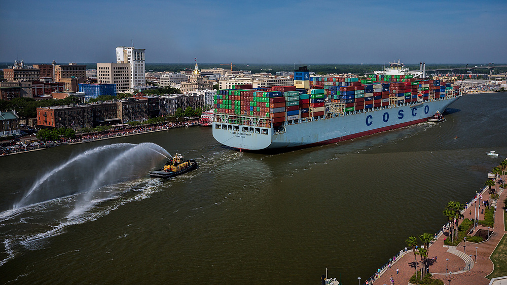In this photo provided by the Georgia Port Authority, Georgia Ports Authority the container ship  Cosco Development sails up river past Historic Downtown Savannah, Ga. to the Port of Savannah, Thursday, May 11, 2017, in Savannah, Ga. At 1,201 feet long and 158 feet wide, the Cosco Development is the largest vessel ever to call on the U.S. East Coast. (AP Photo/Georgia Port Authority, Stephen Morton)