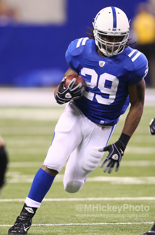 Jan. 08, 2011; Indianapolis, IN, USA; Indianapolis Colts running back Joseph Addai (29) runs the ball against the New York Jets during the 2011 AFC wild card playoff at Lucas Oil Stadium. Mandatory credit: Michael Hickey-US PRESSWIRE