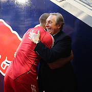 Red Bull soccer global director Gerard Houllier (right) hugs Thierry Henry in the tunnel after warm up during the New York Red Bulls V Sporting Kansas City, Major League Soccer regular season match at Red Bull Arena, Harrison, New Jersey. USA. 17th April 2013. Photo Tim Clayton