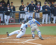 Ole Miss' Preston Overbey (1) is tagged out by Memphis catcher Keaton Aldridge (23) at Oxford-University Stadium in Oxford, Miss. on Tuesday, February 26, 2013. Memphis won 4-3. Ole Miss falls to 7-1.