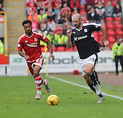 Dundee's Gary Harkins goes past Aberdeen&rsquo;s Shaleum Logan - Aberdeen v Dundee at Pittodrie<br /> - Ladbrokes Premiership<br /> <br />  - &copy; David Young - www.davidyoungphoto.co.uk - email: davidyoungphoto@gmail.com
