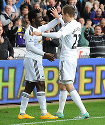 Swansea City's Wilfried Bony celebrates with Swansea City's Gylfi Sigurosson - Photo mandatory by-line: Alex James/JMP - Mobile: 07966 386802 - 29/11/2014 - Sport - Football - Swansea -  - Swansea v Crystal palace  - Barclays Premier League
