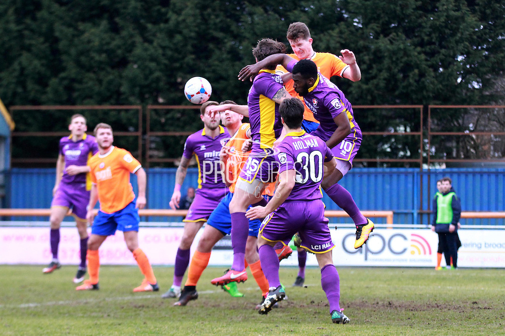 The Robins battling for the ball during the Vanarama National League match between Braintree Town and Cheltenham Town at the Amlin Stadium, Braintree, United Kingdom on 19 March 2016. Photo by Carl Hewlett