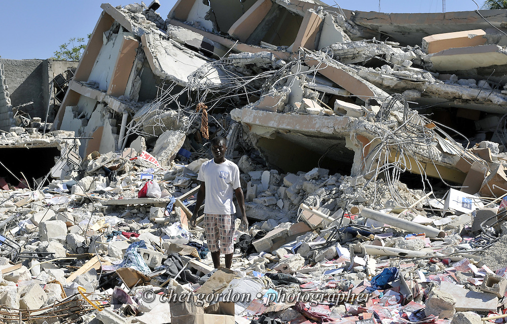 A man collects personal effects in the rubble of his home in Port-au-Prince, Haiti on Saturday, January 30, 2010. A massive 7.0 earthquake struck the Caribbean island nation on January 12th., killing upwards of 200,000 people.