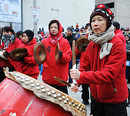 February 13, 2011 - Rev. Cheng Imm Tan, Gund Kwok troupe leader, plays the drums during the group's performance of the traditional Dragon Dance as part of New Year celebrations in Boston's China Town.