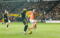 BLACKPOOL, ENGLAND - Wednesday, January 12, 2011: Liverpool's Fernando Torres scores the opening goal against Blackpool during the Premiership match at Bloomfield Road. (Photo by David Rawcliffe/Propaganda)