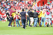 Burnley fans rushed the pitch after the final whistle during the Sky Bet Championship match between Charlton Athletic and Burnley at The Valley, London, England on 7 May 2016. Photo by Matthew Redman.