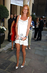 Model OLIVIA INGE at the annual Michele Watches Summer Party held in the gardens of Home House, 20 Portman Square, London W1 on 15th June 2006.<br />