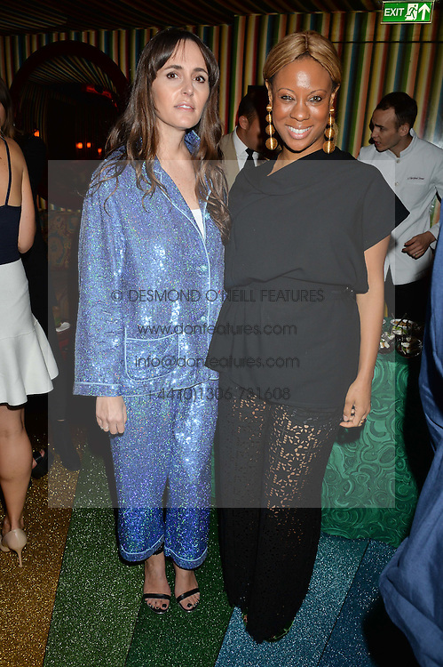 Left to right, TANIA FARES and STEPHANIE HORTON at a party hosted by fashion website Farfetch to launch i.am + EPs headphones hosted by Will.i.am at Loulou's, 5 Hertford Street, London on 16th September 2016.