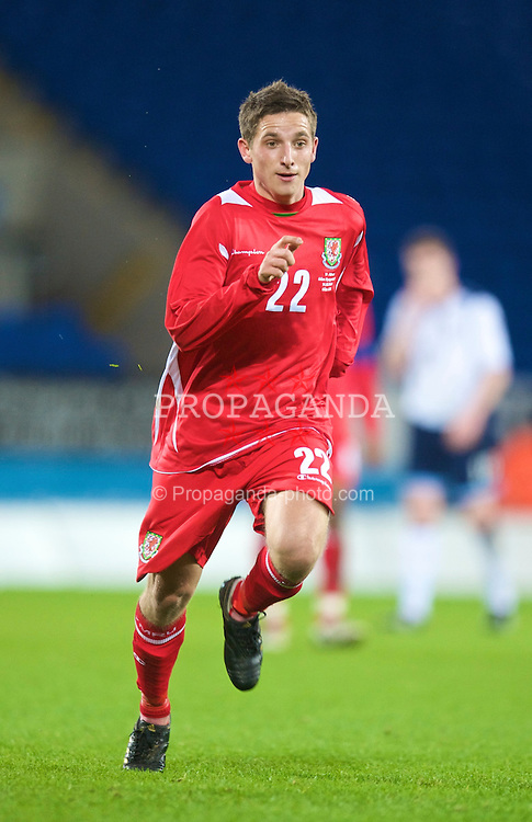 CARDIFF, WALES - Saturday, November 14, 2009: Wales' Joe Allen in action against Scotland during the international friendly match at the Cardiff City Stadium. (Pic by David Rawcliffe/Propaganda)