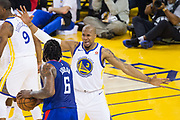 Golden State Warriors forward David West (3) defends LA Clippers center DeAndre Jordan (6) after being hit in the eye on a previous play at Oracle Arena in Oakland, Calif., on January 10, 2018. (Stan Olszewski/Special to S.F. Examiner)