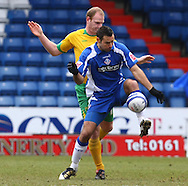 Oldham - Saturday February 26th, 2010 :  Gary Doherty of Norwich and Pawel Abbott of Oldham in action during the Coca Cola League One match at Boundary Park, Oldham. (Pic by Paul Chesterton/Focus Images)..