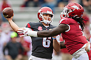 FAYETTEVILLE, AR - MARCH 6:   Ben Hicks #6 of the Arkansas Razorbacks throws a pass under pressure from McTelvin Agim #3 during the annual Spring Game at Razorback Stadium on March 6, 2019 in Fayetteville, Arkansas.  (Photo by Wesley Hitt/Getty Images) *** Local Caption *** Ben Hicks; McTelvin Agim