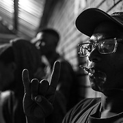 A young man in the audience during the Punk Fuck skate and music event in Soweto. Johannesburg, South Africa. April 2017. © Miora Rajaonary / Native Agency