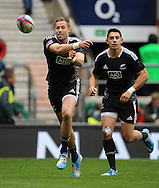 LONDON, ENGLAND - Sunday 11 May 2014, Tim Mikkelson of New Zealand passes the ball to the backline during the Cup quarter final match between South Africa and New Zealand at the Marriott London Sevens rugby tournament being held at Twickenham Rugby Stadium in London as part of the HSBC Sevens World Series.<br /> Photo by Roger Sedres/ImageSA