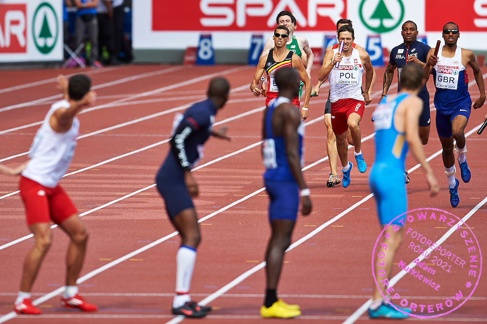 (C) Kacper Kozlowski from Poland competes in Men's Relay 4 x 400 meters final during the Sixth Day of the European Athletics Championships Zurich 2014 at Letzigrund Stadium in Zurich, Switzerland.<br /> <br /> Switzerland, Zurich, August 17, 2014<br /> <br /> Picture also available in RAW (NEF) or TIFF format on special request.<br /> <br /> For editorial use only. Any commercial or promotional use requires permission.<br /> <br /> Photo by &copy; Adam Nurkiewicz / Mediasport