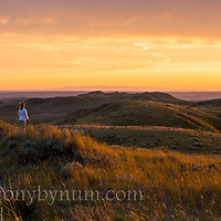 warm sunset on the prairie woman watching sun go down valley county montana conservation photography - montana wild prairie