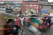 A blur of vehicles in nearly gridlocked traffic in Chandni Chowk, Old Delhi, India.