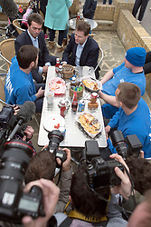 """© Licensed to London News Pictures. 13/04/2015. Carshalton, UK. Nick Clegg (L) and Tom Brake talk to customers at """"Bakery"""" on Carshalton High Street.  Leader of the Liberal Democrats and Deputy Prime Minister Nick Clegg visits Carshalton and Wallington constituency on Monday (13th April) with Lib Dem candidate Tom Brake.  Photo credit : Stephen Simpson/LNP"""