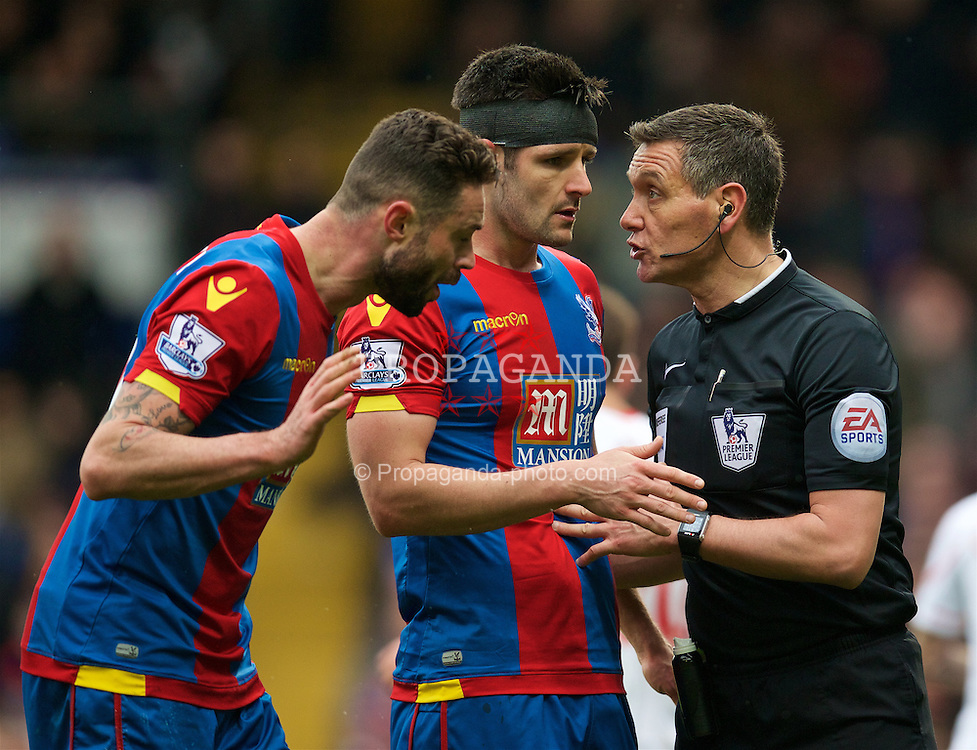 LONDON, ENGLAND - Sunday, March 6, 2016: Crystal Palace's Damien Delaney and Scott Dann argues with referee Andre Marriner after a penalty is awarded to Liverpool during the Premier League match at Selhurst Park. (Pic by David Rawcliffe/Propaganda)