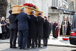 © licensed to London News Pictures. London, UK 27/03/2014.The coffin of Tony Benn arriving at St Margaret's Church, Westminster ahead of his funeral at St Margaret's Church, Westminster, London. Former cabinet minister and veteran left-wing campaigner Tony Benn died at home on March 14th following a long term illness. Photo credit: Tolga Akmen/LNP