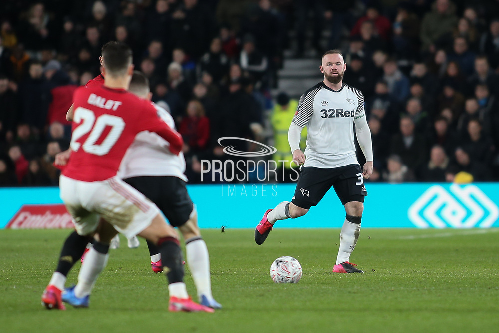 Derby County midfielder/coach Wayne Rooney passes the ball during the The FA Cup match between Derby County and Manchester United at the Pride Park, Derby, England on 5 March 2020.