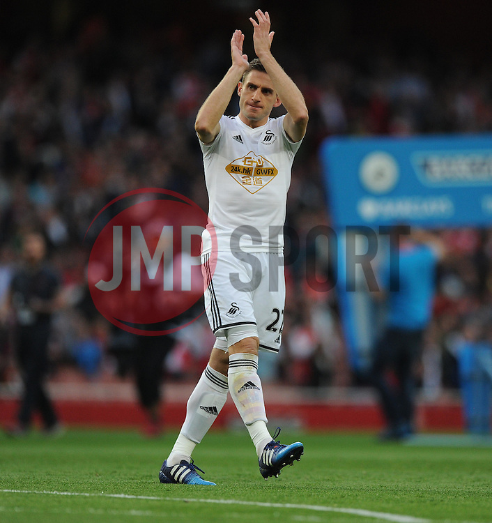 Swansea City's Angel Rangel claps the swansea fans as they come onto the Emirates pitch. - Photo mandatory by-line: Alex James/JMP - Mobile: 07966 386802 - 11/05/2015 - SPORT - Football - London - Emirates Stadium - Arsenal v Swansea City - Barclays Premier League