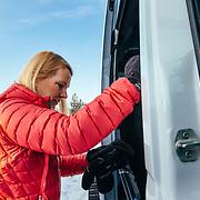 Rhonda Watson climbs aboard the Teton Science School's 4 x 4 Sprinter.