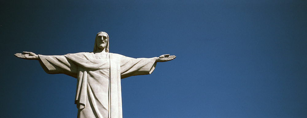 A panoramic view of the iconic Cristo Redentor, Christ the Redeemer statue on Mount Corcovado. Rio de Janeiro, Brazil.  The Jesus Christ statue was voted one of the seven wonders of the modern world in 2007. Rio de Janeiro, Brazil. 11th December 2011. Photo Tim Clayton..