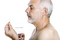 caucasian man portrait taking medecine pill isolated studio on white background