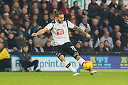Derby County midfielder Bradley Johnson makes a long-ball pass during the EFL Sky Bet Championship match between Derby County and Wigan Athletic at the iPro Stadium, Derby, England on 31 December 2016. Photo by Aaron  Lupton.
