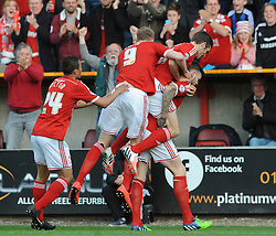 Swindon Town's Ben Gladwin celebrates with his team mates after scoring a goal - Photo mandatory by-line: Dougie Allward/JMP - Mobile: 07966 386802 - 11/05/2015 - SPORT - Football - Swindon - County Ground - Swindon Town v Sheffield United - Sky Bet League One - Play-Off