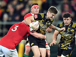 """Jordie Barrett of the Hurricanes is held by Dan Cole of the Lions in the International rugby match between the the Super Rugby Hurricanes and British and Irish Lions at Westpac Stadium, Wellington, New Zealand, Tuesday, June 27, 2017. Credit:SNPA / Ross Setford  **NO ARCHIVING"""""""