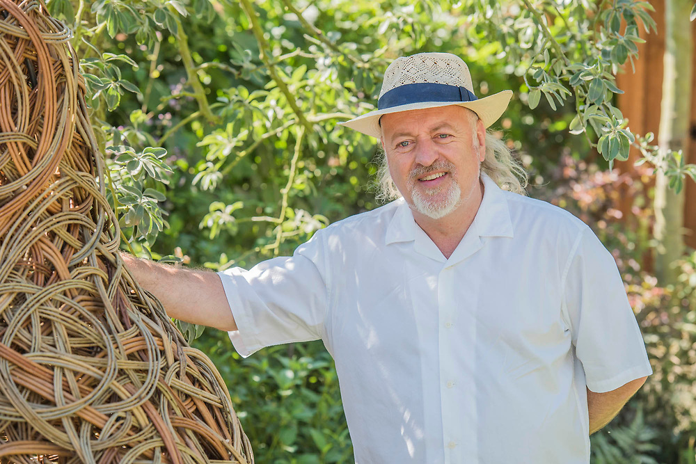 Bill Bailey on the Family Garden designed by LillyGomm -  Press day at The RHS Hampton Court Flower Show.