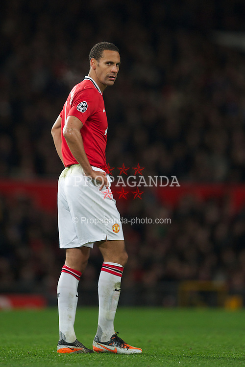 MANCHESTER, ENGLAND - Tuesday, November 22, 2011: Manchester United's Rio Ferdinand looks dejected after his mistake gifted SL Benfica an equalising goal to level 2-2 during the UEFA Champions League Group C match at Old Trafford. (Pic by David Rawcliffe/Propaganda)