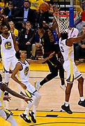 May 31, 2018; Oakland, CA, USA; Cleveland Cavaliers forward LeBron James (23) shoots the ball against Golden State Warriors forward Kevon Looney (5) during the third quarter in game one of the 2018 NBA Finals at Oracle Arena.