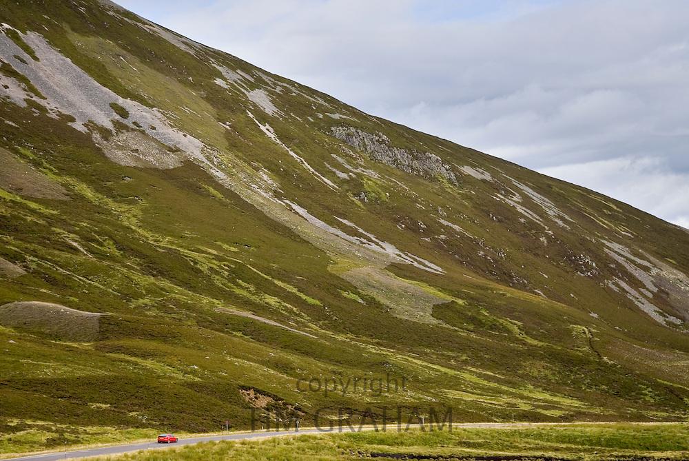 Car drives through the Glen Clunie hills, Scotland