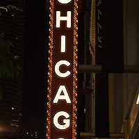 Chicago Theatre sign at night. The Chicago Theatre is a popular venue for concerts and stage performances and is a landmark listed with the National Register of Historic Places.