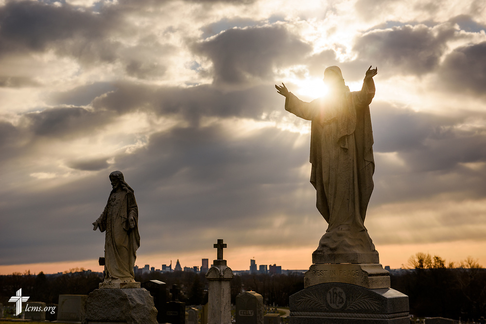 Headstone monuments depicting Jesus Christ accent the Baltimore skyline as the sun rises early Palm Sunday, March 25, 2018. LCMS Communications/Erik M. Lunsford