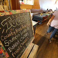 Hailey McMinn, a watiress at Southern Eatery in Holly Springs, moves through the resturant during the busy lunch time rush on Tuesday.