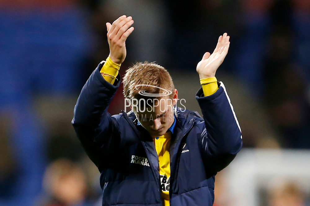 Disappointed  Marcus Forss of Wimbledon applauds the fans at full time during the EFL Sky Bet League 1 match between Bolton Wanderers and AFC Wimbledon at the University of  Bolton Stadium, Bolton, England on 7 December 2019.
