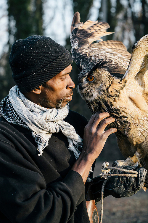Rodney Stotts with his Eurasian eagle owl, Hoots, before the annual Lower Beaverdam Creek cleanup in Hyattsville, Md. on March 17, 2016.