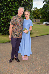 LAURA BAILEY and JOSH WOOD at The Ralph Lauren & Vogue Wimbledon Summer Cocktail Party at The Orangery, Kensington Palace, London on 22nd June 2015.  The event is to celebrate ten years of Ralph Lauren as official outfitter to the Championships, Wimbledon.