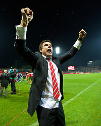 ZENICA, BOSNIA & HERZEGOVINA - Saturday, October 10, 2015: Wales' manager Chris Coleman celebrates qualifying for the Euro 2016 finals despite a 2-0 defeat to Bosnia and Herzegovina during the UEFA Euro 2016 qualifying match at Stadion Bilino Polje. (Pic by David Rawcliffe/Propaganda)