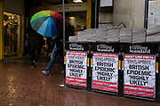 As the Coronovirus pandemic takes hold across the UK, with health authorities reporting cases rising from 25 to 87 in a single day, and resulting in the UK's chief medical officer Prof Chris Whitty announcing that an epidemic in the UK was 'highly likely', Londoners pass-by Evening Standard headlines outside Embankment Underground station, on 4th March 2020, in London, England.
