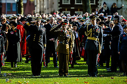 Members of the armed forces salute while on parade during a Remembrance Sunday service in Queen's Square, Bristol, held in tribute for members of the armed forces who have died in major conflicts.