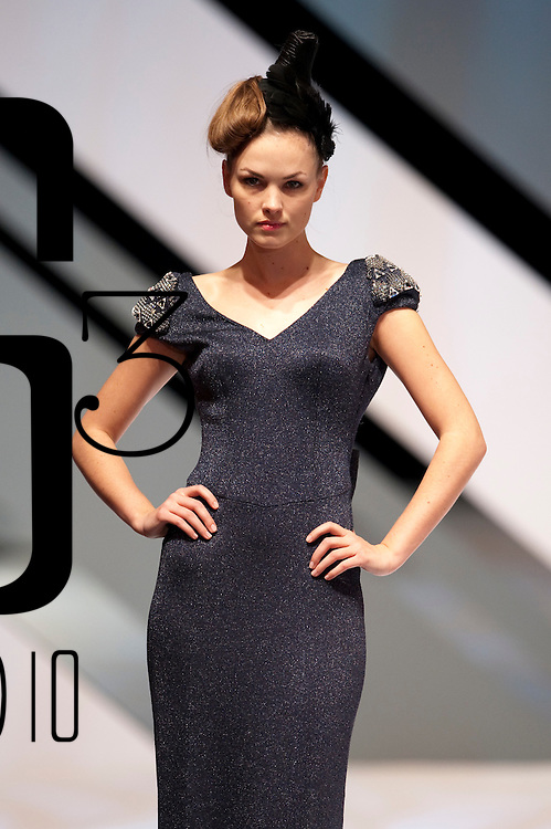 HONG KONG - JANUARY 18:  A model showcases design by Gioia Pan on the catwalk during the Taiwan Textile Federation show as part of the  Hong Kong Fashion Week Fall/Winter 2010 on January 18, 2010 in Hong Kong.  Photo by Victor Fraile / studioEAST