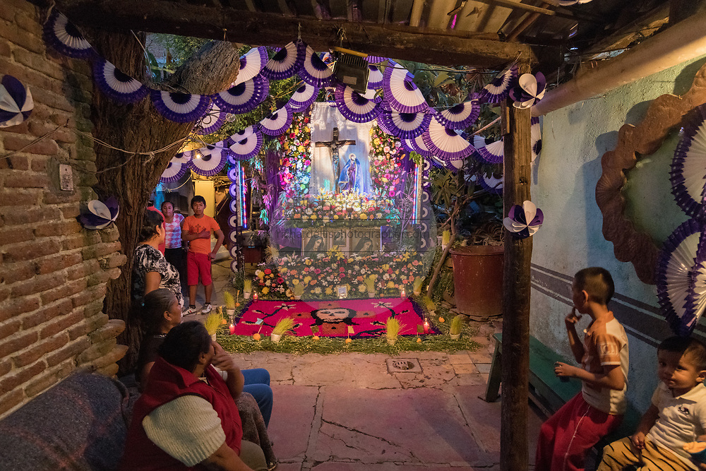 A Mexican family welcomes guest to view their altar made from flowers celebrating El Viernes de Dolores during Holy Week at a home March 23, 2018 in San Miguel de Allende, Mexico. The event honors the sorrow of the Virgin Mary for the death of her son and is an annual tradition in central Mexico.